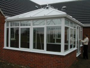 An Example of First's White uPVC Hipped Back Edwardian Conservatory From First Home Improvements