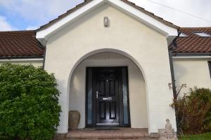 First Meridian Oak Black Composite Door with Black Glazed Side Panels