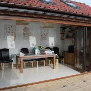 Rosewood uPVC Bi-Fold Doors With Golden Oak Frame