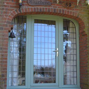 Chartwell Green Window with arched head with square leaded glass