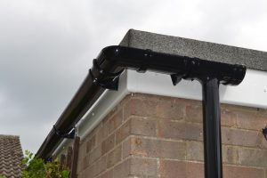 White Fascia board with black guttering