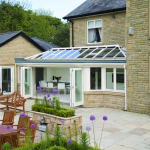 White uPVC conservatory with glass roof