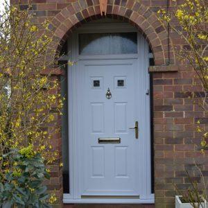 First Queens white uPVC door with top light