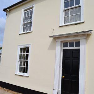 White vertical slider sash windows with Georgian bars
