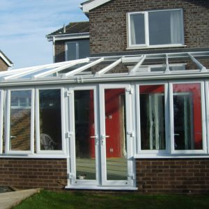White Lean-to uPVC conservatory with dwarf wall