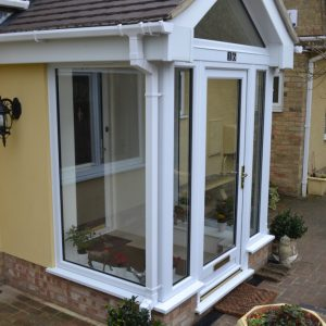 Glass porch entrance with tiled roof