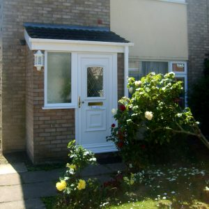 Brick porch with double glazed door and tiled roof